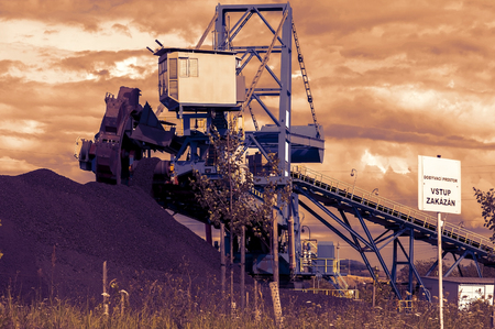 browncoal: A giant wheel excavator in brown coal mine in the sunset
