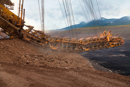 lignite: A giant bucket wheel excavator at work in a lignite mine pit