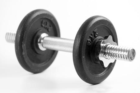 muscle toning: Black dumbbell on white background Stock Photo