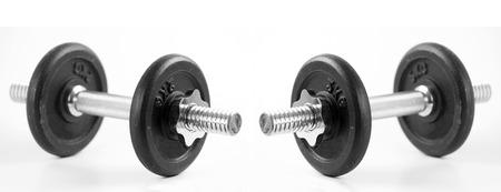 muscle toning: Black dumbbells on white background