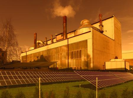 cielo atardecer: Industrial building with solar panels, sunset sky Foto de archivo