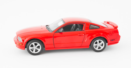red sports car: Red sports car miniature on white background
