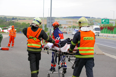 evacuate: CZECH REPUBLIC Pilsen, SEPTEMBER 30, 2015: Czech rescue team, helicopter Evacuate Injured after a car accident on September 30th 2015.