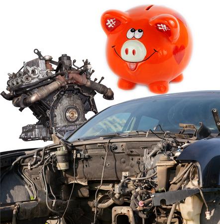 scrap car: Concept of Car wreck and orange piggy bank style money box Stock Photo
