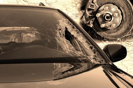 windscreen: Broken windscreen at black car in traffic accident and disc brake