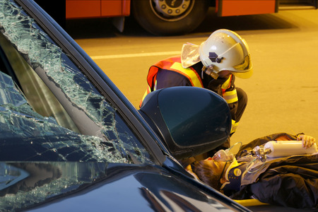 relieve: CZECH REPUBLIC, PLZEN, SEPTEMBER 30, 2015: The Brave firefighter Relieve an Injured After Car Accident