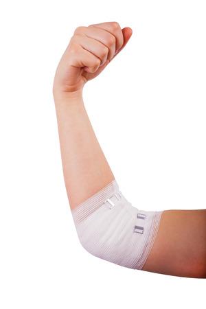 white bandage: Isolated hand of woman, Injured painful elbow with white bandage
