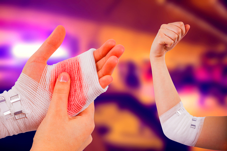 white bandage: Injured hand and painful elbow with white bandage on abstract background