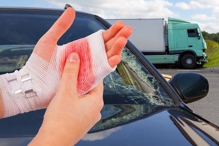 white bandage: Injured isolated hands tied up by white bandage at car accident