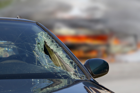 windscreen: Broken windscreen at black car in traffic accident