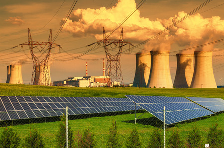 dukovany: Nuclear power plant Dukovany with solar panels at sunset in Czech Republic Stock Photo