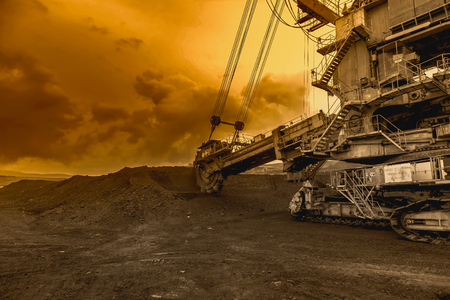 Giant bucket wheel excavator in sunset sky Stock Photo