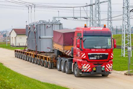 CZECH REPUBLIC, P?E?TICE, NOVEMBER 11, 2014: Transport of heavy, oversized loads and construction machinery Stock Photo - 60602617