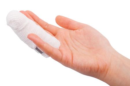 cut wrist: Injured finger with bandage isolated on white background