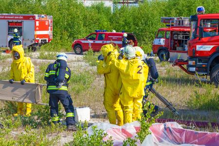 CZECH REPUBLIC, PLZEN, Junya 4, 2014: Fire Departments and emergency teams in hazmat suits.