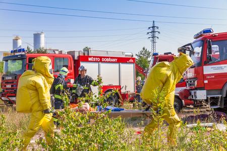 hazmat: CZECH REPUBLIC, Dobrani, JUNE 4, 2014: Mans in protective hazmat suit and fire trucks