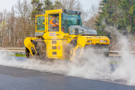 vibroroller: CZECH REPUBLIC, PLZEN, MAY 7, 2016: Asphalt spreading machine and vibration roller at pavement road works.