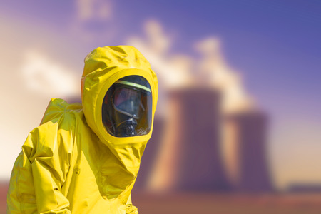protective suit: View of coal power plant smoking and men in protective hazmat suit Stock Photo