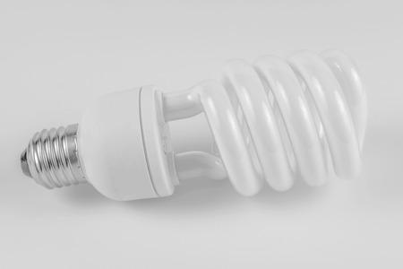 Energy saving fluorescent light bulb on white bakground Banco de Imagens