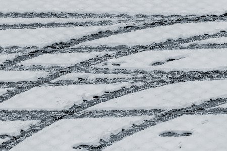 tire tracks: Tire tracks in the snow at winter