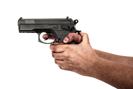 Hand holding a gun isolated on white background
