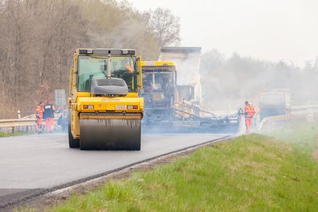 construction vibroroller: CZECH REPUBLIC, PLZEN, APRIL 10, 2016: Asphalt spreading machine and vibration roller at pavement road works.