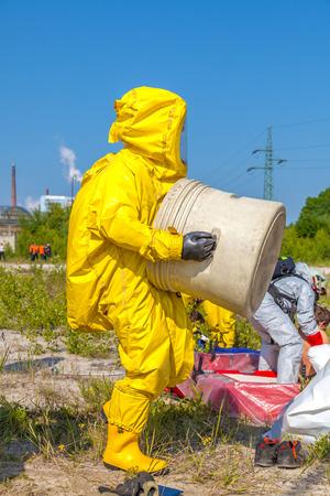 Man in yellow protective hazmat suit