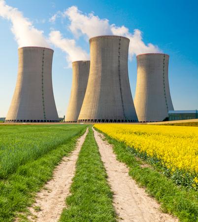 dukovany: Nuclear power plant Dukovany with rape field, Czech Republic