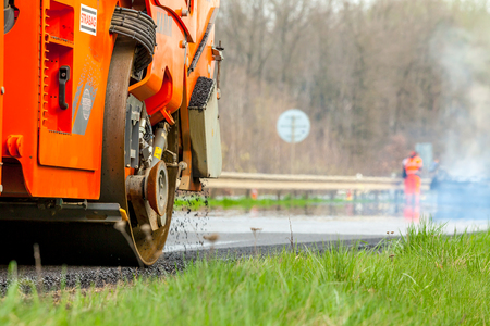 construction vibroroller: CZECH REPUBLIC, PLZEN, MAY 7, 2016: Asphalt spreading machine and vibration roller at pavement road works.