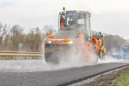 CZECH REPUBLIC, PLZEN, MAY 7, 2016: Asphalt spreading machine and vibration roller at pavement road works.