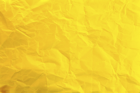 Crumpled yellow paper as background