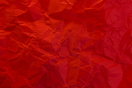 Crumpled red paper as background