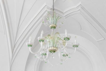 Chandelier on white ceiling, interior