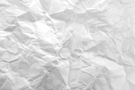 Crumpled white paper as background
