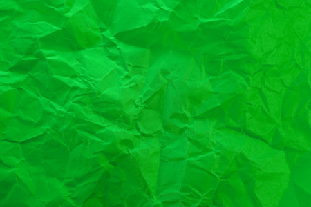 Crumpled green paper as background