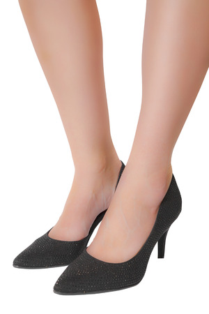 Womans legs with black high heeled shoes Stock Photo