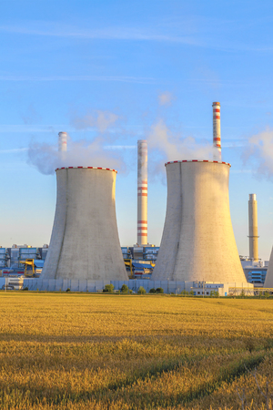 Thermal power plant with grain field Stock Photo