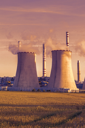 Thermal power plant with grain field at sunset