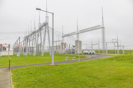 High voltage power substation with gray sky