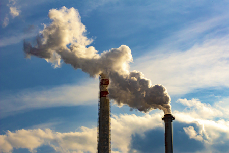 Industrial smoke from chimneys with cloudy sky Standard-Bild - 115746915