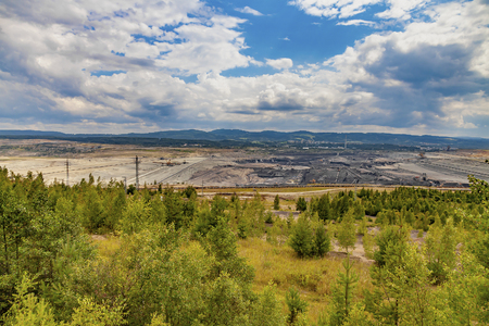 Open coal mining pit with heavy machinery, Most, Czech Republic Stock Photo
