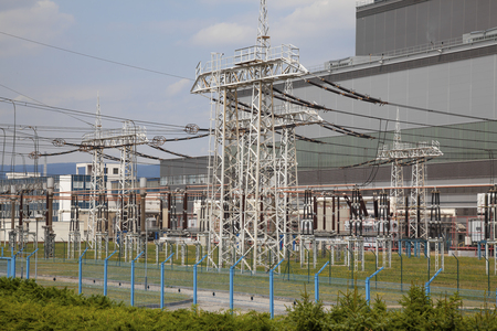 High voltage power substation on cloudy sky