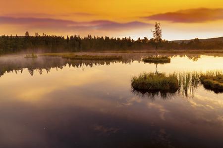 Mountain Lake Laka in Sumava National Park in Czech Republic. Sunset sky.