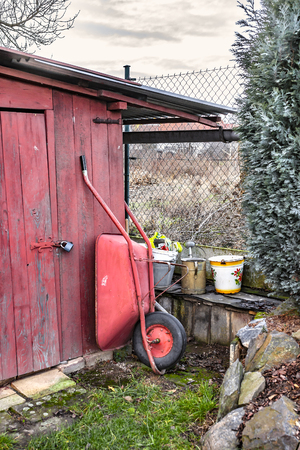 Garden shed and garden tools in the shade