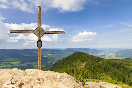 Wooden cross on the summit of a Grosser Osser Mountain in the Bavarian Forest National Park, Germany.
