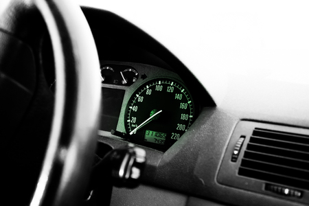 Dashboard of a car with green lights