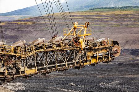 Large yellow conveyor belt carrying. Mining of black coal in Czech Republic.
