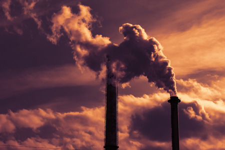 Industrial smoke from chimneys at sunset Imagens