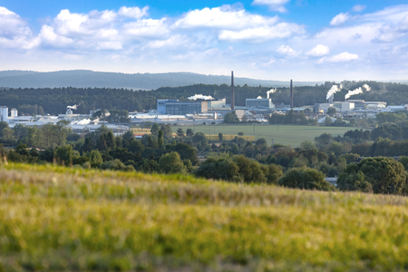 Industrial landscape in Czech Republic. Factory chimneys, manufacturing facility.