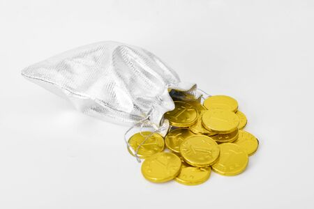 Money bag and gold coins falling from it. | Concept of savings and economy. Stockfoto
